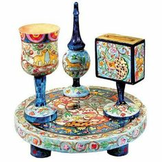 """Yair Emanuel Painted Wood Havdalah Set with Middle Eastern-Inspired Design by World of Judaica. $90.00. Material: Wood. You will be pleasantly surprised! The vast majority of our shipments arrive within 10-14 business days from time of shipment, far in advance of Amazon's default calculation of shipping times for items shipped from Israel.. Your order includes 1 item(s).. Dimensions: 10.6"""" X 8.3"""". The stunningly-colored design of this painted Havdalah Set from Yair Ema..."""