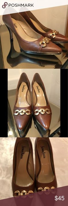 Neiman Marcus Brown leather pointed heels Neiman Marcus - Brown leather with gold detail. Size 8. Pointed closed toe 3 inch heels. Excellent condition -- minimally worn Neiman Marcus Shoes Heels