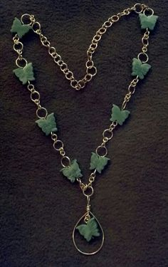 "make a chain in one link at a time . . . add butterflies. I forget what stone these are . . oh yeah ""green"" stone:-P"