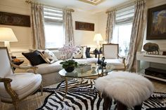 Sitting Room By: Barbara Ostrom. Ostrom's sitting room includes tons of millwork, gold-leaf Venetian plaster on the ceiling, a zebra hide, and geese tabletop sculptures.