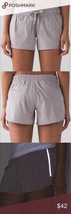 "Lululemon Hotty Hot ""Long"" NWOT.  Relaxed fit.  Lay flat drawstring.  Reflective detail.  4""inseam Lululemon Shorts"