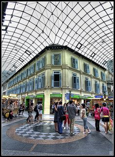 Bugis Junction, one of Singapore's most popular shopping malls, is actually an old street that was covered by a glass dome and converted to a mall... by Gee!Bee, via Flickr