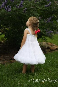 How adorable it is to be a little girl in a special dress. she looks so feminine! no Tom boy there.