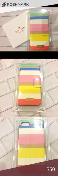 NIP Kate Spade Wrap Folio This cute NIP Kate Spade Dune Stripe wrap folio is Saffiano leather for an iPhone 7. There's a magnetic flap closure and the interior has a slip pocket for a credit card or ID. On the front is the Kate Spade gold-tone logo plaque on a multi-color Dune Stripe design. kate spade Accessories Phone Cases