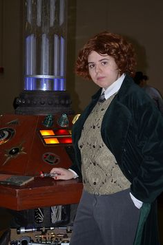 Kayle as the 8th Doctor, in front of the TARDIS console from the 1996 movie.  Photo taken during LoneStarCon3 (aka Worldcon 71).