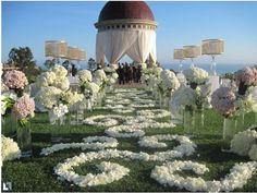 Mark's Garden used white orchids, roses and hydrangeas for the Pelican Hill Resort wedding of Paul Pierce and Julie Landrum. Wedding Aisles, Wedding Venues, Red Wedding, Perfect Wedding, Wedding Flowers, Wedding Stuff, Spring Wedding, Wedding Bells, Outdoor Wedding Decorations