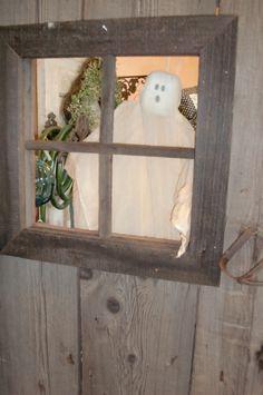 Halloween Decor..Old barnwood door,w/vintgae hardwarer..reclaimed from local barn..ghost made w/  gauze,wood & wire..can be purchased @ Ebb n'Flow,Patio,Home & Garden...www.ebbnflow.net