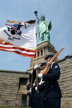 Statute of Liberty and U.S.C.G. members