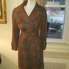 Trimingham wool vintage trench L-XL Stunning hundred wool trench . This will fit a variety of sizes and measures 18 inches shoulder to shoulder and 20 inches pit to pit. There had been repairs to the lining but this is still a fabulous coat. Please do not bundle with items that will cause shipping to exceed 5 pounds. Vintage Trimingham Jackets & Coats Trench Coats