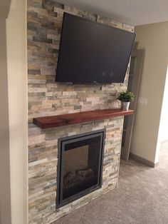 Master Bedroom Accent Wall with TV, electric fireplace ( Lennox ), and Cedar mantel.