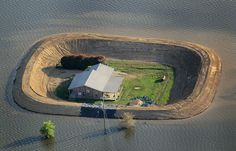 A levee protects a home surrounded by floodwater from the Yazoo River, on May 18, 2011 near Vicksburg, Mississippi.