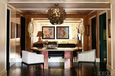 Metallic living room with crown molding, white armchairs, and luxurious chandelier