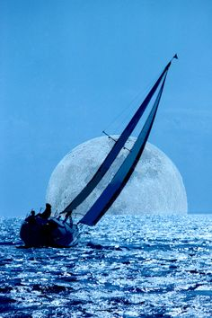 "Original Caption: 500px / Photo ""Moonlight Sailing"" by Sherwood Burton. Doc's Caption: what is up with the fascination with over sized moons Photoshopped into pictures?? This is a bad daylight shot with a zoomed in moon pasted in. Photoshop level: 1 - not even trying to hide the daylight. Gah! I have to stop picking on bad moon shots...they are too easy!"