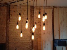 Stuck 12 light bulbs to the ceiling. Really happy about the result. #lightbulbs #edison #diningroom #brickwall #industrial