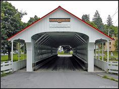Ashuelot Covered Bridge    Ashuelot Covered Bridge in NH built in 1864. The Ashuelot or Upper Village Bridge is a two span Town Lattice Truss with a total length of 159 feet. It carries Old Ashuelot Road over the Ashuelot River in the town of Winchester.