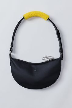 Acne Studios Funpack dark blue is a small shoulder bag with a classic silhouette constructed of materials like soft, canvas lined calf leather paired with colourful shearling. Lv Handbags, Leather Handbags, Fashion Bags, Fashion Backpack, London Fashion, Fashion Fashion, Runway Fashion, Fashion Trends, Calf Leather