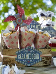 Fourth of July Caramel Corn ... LOVE the paper pin wheels and the popcorn cones! FUN!