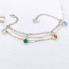 Personalised Birthstone Charm Bracelet handcrafted by Lilia Nash with your choice of up to 6 ethically sourced birthstones. Click to find out more.