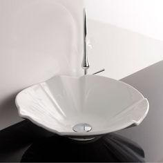 Ceramica Valdama White Bathroom Vessel Sink.  Artistic modern ceramic washbasin with the greatest imaginable versatility in appication. Models that adhere to the more current trends of design, harmony, and elegance. Made in Italy to highest industry standards. -- Julianna