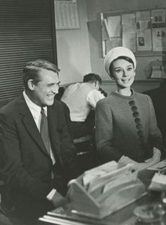 Cary Grant and Audrey Hepburn on the set of Charade (1963).