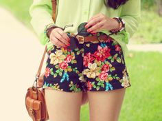 flowery shorts and the green shirt