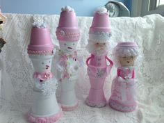 These shabby chic darlings were made with clay pots...Mr and. Mrs Claus and mr and mrs Snowman.
