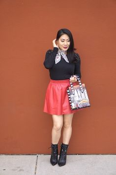 Red skirt and black top and laced up booties. Awesome fashion women's outfit style