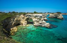 Island of Sant'Andrea in Venice  Torre Sant Andrea, Rocky beach in Puglia, Italy © javarman / Shutterstock
