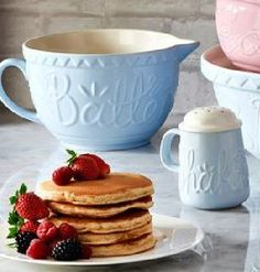 American style pancakes with strawberries and maple syrup.