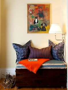 Designer Melody Rubin from House of Ruby Interior Design transformed an old chest into a comfortable seating area. The chest is covered with a cushion and pillows.