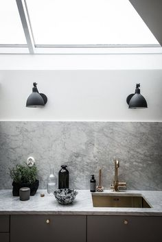 Gray kitchen, marble, black sconces