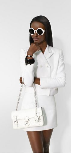 Sophisticated Summer: Tailored white separates with white accessories make a statement. The Ricky ID Chain Bag is handcrafted in Italy from ultra-soft nappa leather and features a gleaming silver-toned chain shoulder strap.