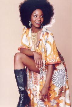 I love the retro 70's album cover/foxy brown/Cleopatra Jones look of this photo