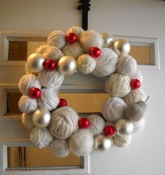 Great for a knitter's household // Christmas Yarn Ball Wreath by prettiesbyme on Etsy, $60.00