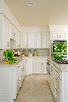 Suzie: Tobi Fairley - Amazing kitchen with white kitchen cabinets, granite countertops, cooktop ...: