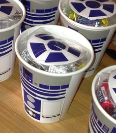 R2D2 candy cups for a Star Wars birthday http://catchmyparty.com/blog/diy-tutorial-how-to-make-r2d2-cups-for-your-star-wars-party