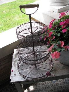 Three Tiered Wire Stand Finding a place to store items can sometimes be a tedious task. When you add this charming three tiered wired stand to your home, you will find a fun and stylish way to not onl