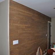 via Hometalk's KMS Woodworks - you can use laminate flooring on the wall to make a rustic impression!