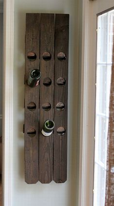 wine bottle storage from old fence planks. . .