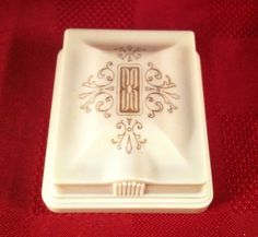 Antique Celluloid Art Deco Double Ring Box  This pattern is very intricate and simple. I also like the fluer de lis detailing. Might not necessarily compliment the ring though.