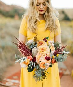 southwest fall inspired bouquet with peachy florals and touches of burgundy for the boho bride in the desert if I have a fall wedding Dahlia Wedding Bouquets, Dahlia Bouquet, Yellow Bouquets, Wedding Flowers, Astilbe Bouquet, Wedding Color Schemes, Wedding Colors, Chic Wedding, Floral Wedding