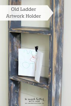 Old ladder artwork holder via somuchbetterwithage.com #oldladders #ladders #kidsartwork