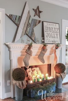 Pretty Christmas mantel! Love that giant reclaimed wood star.  Pretty burlap stockings too.