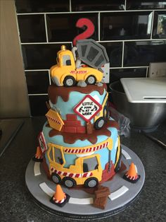 Construction  birthday cake. Diggers. Dumper trucks. Crane. Building site. Jcb. Second birthday. Fondant. Sugar paste.