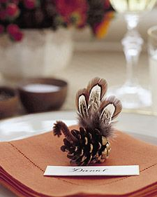 This place-card companion might not take center stage, but it will still be a welcome addition to your table. To make the head and beak, bend a 3-inch piece of brown pipe cleaner, and affix it to the top of a pinecone with craft glue. Glue 3 feathers (available at crafts-supply stores) near the base. Station one turkey at each setting with a place card.