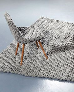 Extra Dose of 'Cuddly' into Modern Furniture wool rug chair decor