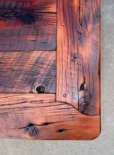 I love the corner detail on this rustic tabletop made from barn wood planks. We have to remove the desk from the family room to put in the new floors. We're going to reconfigure it from a corner desk to a straight desk along the wall when we reinstall it. I want to reuse the base cabinets to support a new top. I'm thinking of using old Louisiana cypress planks to build a top with some character.