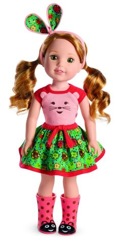 "Wellie Wisher Willa ~ ""Willa has a love for animals. She's sure to be the first one up a tree — and the last to turn away a furry friend.""  She's wearing a little hedgehog t-shirt and bunny ears."