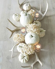 A whiter shade of pale! My autumn centerpiece of white pumpkins, dried hydrangeas, shed antlers and votives on a bleached dining table. From last season. Happy Sunday! #toneontoneantiques #falldecor #centerpiece