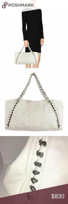 CHANEL White Leather Handbag Purse CHANEL Winter White CC Logo Silver Chain LUXE LIGNE Shopper Tote Handbag  Measurements:  17 1/2in Width,  5in depth 11in height 9in strap drop  Manufacturer: Chanel Style Name: Luxe Ligne Chain Around Tote Material: White lambskin leather Metal: Gunmetal Interior Lining: White leather Interior Pockets: One zipper pocket and two patch pockets  Handles: Double braided leather and chain entwined handles Closure/Opening: Single magnetic snap closure Origin…